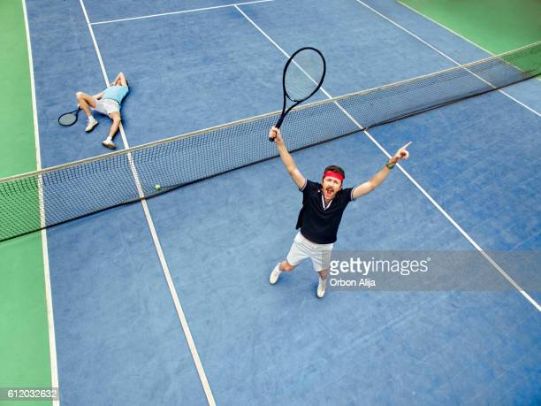 man winning a tennis match - defeat stock photos and pictures