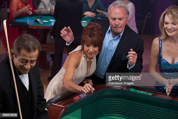 man winning at craps - gambling table stock pictures, royalty-free photos & images