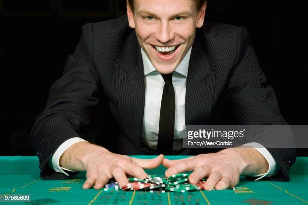 man winning roulette game - gambling table stock pictures, royalty-free photos & images