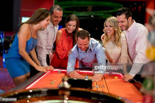 man winning while playing roulette at the casino - green bay wisconsin imagens e fotografias de stock