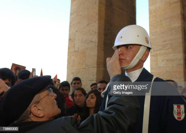A man wipes tears from the face of a Turkish soldier during a rally against Turkish Prime Minister Tayyip Erdogan's possible candidacy to the...