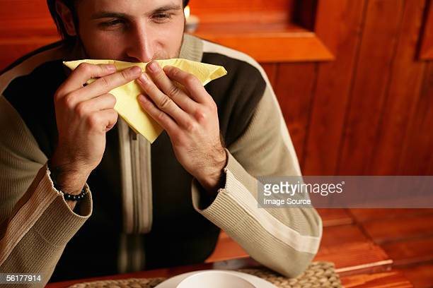 man wiping his mouth with napkin - rubbing stock pictures, royalty-free photos & images