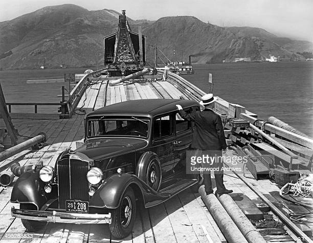Man with a 1933 Packard on the trestle to the South Tower during the beginning of the construction of the Golden Gate Bridge, San Francisco,...