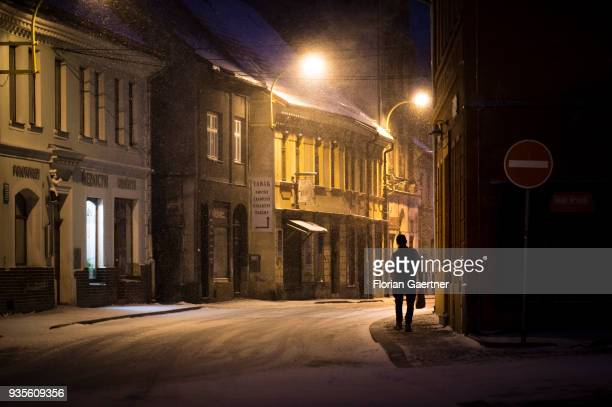 A man with a bag walks the old town on March 17 2018 in Frydland Czech Republic
