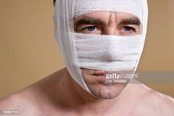 Man with a bandaged face