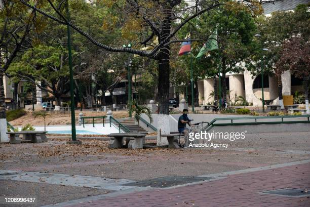 A man with a bicycle in empty Altamira Square as a preventive measure against the new type of coronavirus pandemic in Caracas Venezuela on April 02...