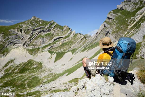 Man with a big bagpack in front of the beautiful landscape of Durmitor