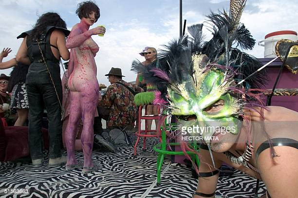 A man with a bird mask walks near a mobile bar during the Burning Man Festival in the Black Rock City Desert in Nevada 30 August 2000 An estimated...