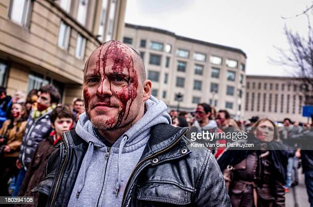 CONTENT] A man with a bloodied face is seen at a zombie parade in Brussels 6th april 2013 In the framework of the 31st Brussels International...