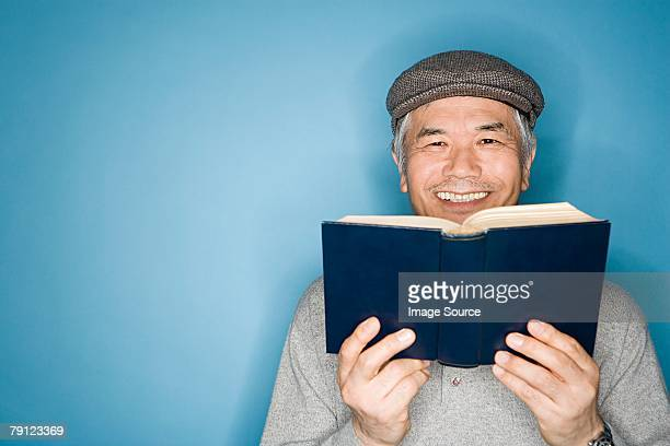 man with a book - flat cap stock pictures, royalty-free photos & images