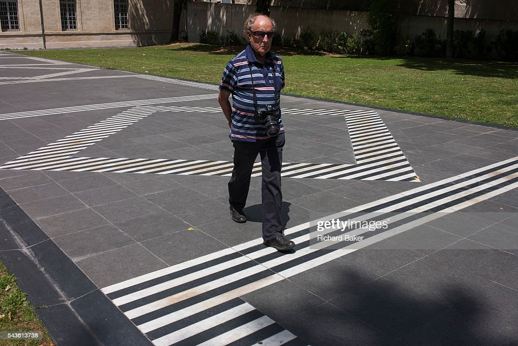 man on striped walkway pictures getty images