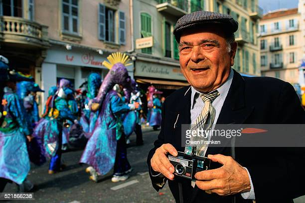 man with a camera at a mardi gras parade - gras bildbanksfoton och bilder