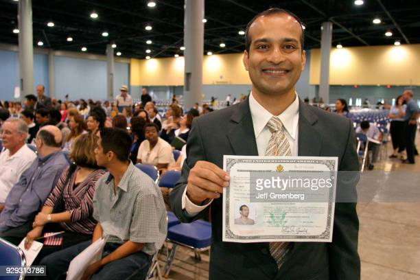 A man with a Certificate of Naturalization at the naturalization ceremony at Miami Beach