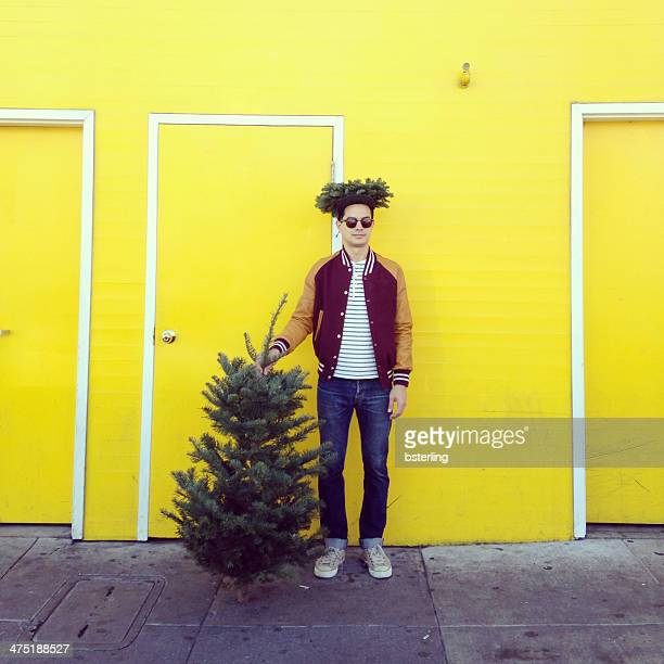 Man with a Christmas tree