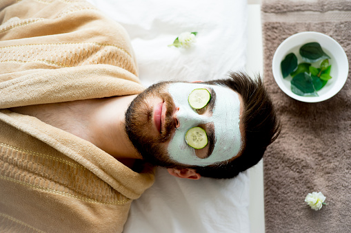 Man with a clay mask 803921518