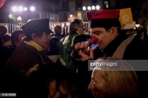 A man with a clown nose lights a tobacco pipe during a march in support of imprisoned Catalan independentist leaders in Barcelona Catalonia Spain on...