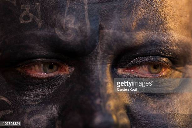 A man with a completely tattooed face attends the Berlin Tattoo Convention at Tempelhof Airport on December 4 2010 in Berlin Germany The Tattoo...