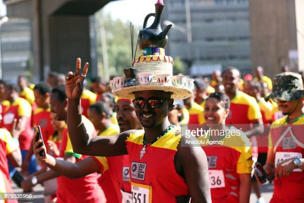 A man with a custom hat gestures during the Great Ethiopian Run at Adwa Square in Addis Ababa Ethiopia on November 26 2017 Total of 44000...