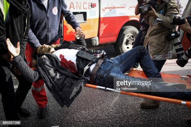 A man with a device attached to his body is carried on a stretcher after being shot by soldiers after he went on a stabbing attack in the area on...