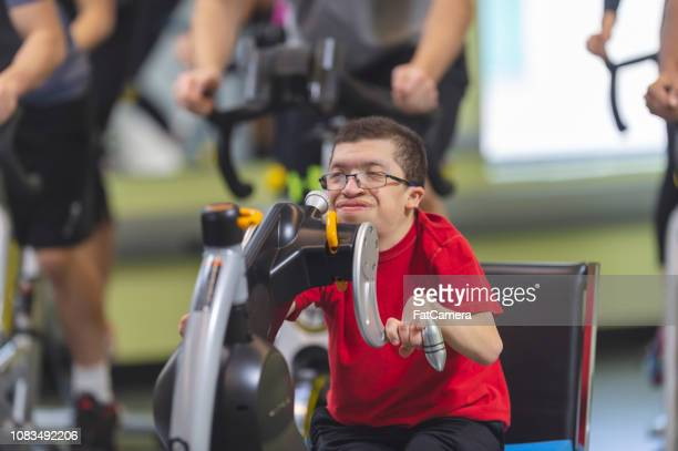 man with a disability working out - human powered vehicle stock photos and pictures