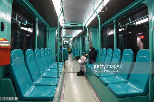 """Man with a face mask sits on a bus on March 08, 2020 in Milan, Italy. Prime Minister Giuseppe Conte announced overnight a """"national emergency"""" due to..."""
