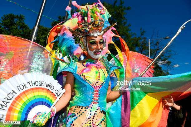 A man with a fancy dress poses during the WorldPride 2017 parade in Madrid on July 1 2017 Revellers took to the rainbow streets of Madrid today in...