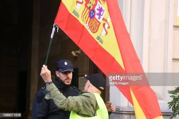 A man with a flag seen greeting an agent of the Spanish National Police during the event Two thousand people celebrated the 40th Anniversary of the...