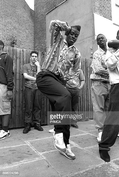 A man with a flat top dancing Notting Hill Carnival London UK 1980s