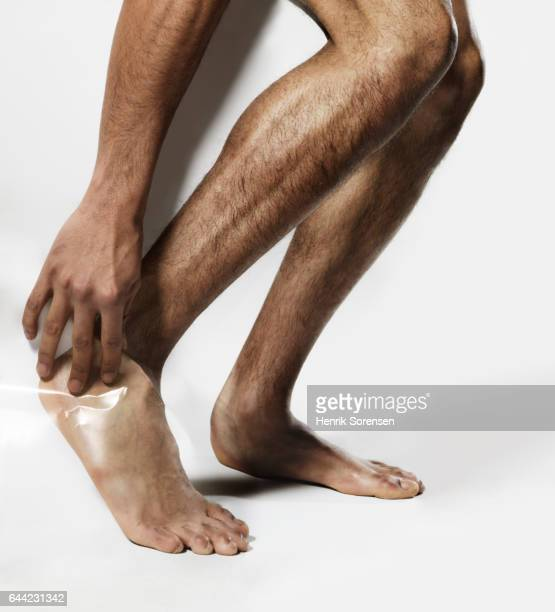 man with a foot injury - human limb stock pictures, royalty-free photos & images