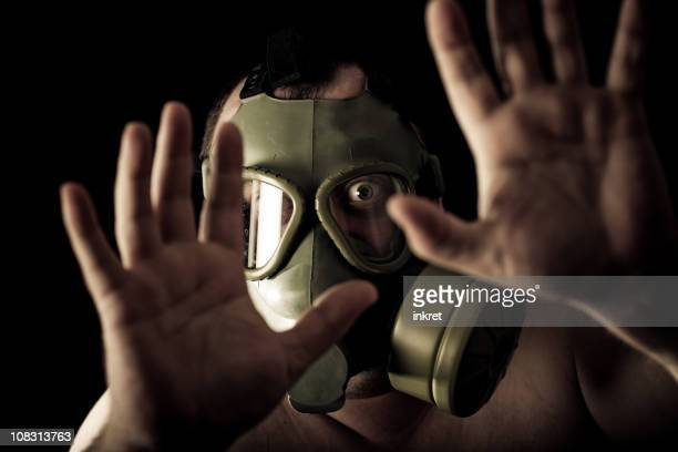 man with a gas mask - air respirator mask stock pictures, royalty-free photos & images