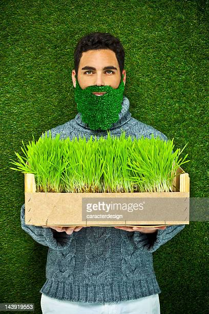 man with a grass beard thinking green - ecologist stock pictures, royalty-free photos & images