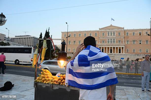 A man with a Greek flag at Syntagmma Square Tourism is considered one of the strong points of Greece's crumbling economy as the international Media...