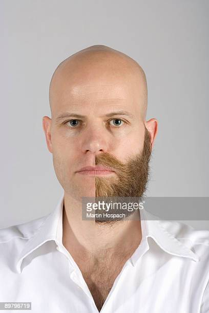 A man with a half shaven beard and mustache