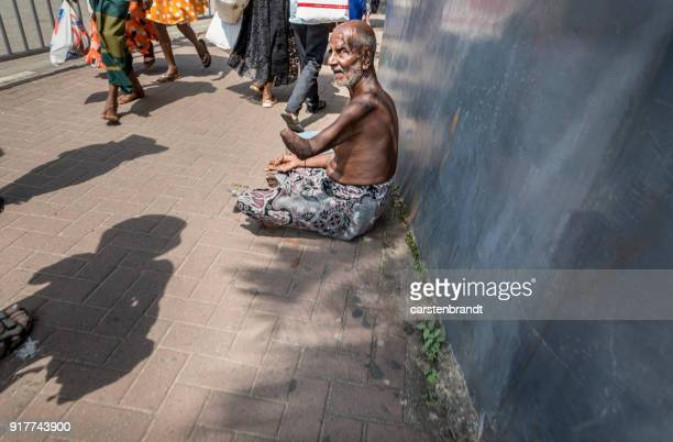Man with a handicap begging for money