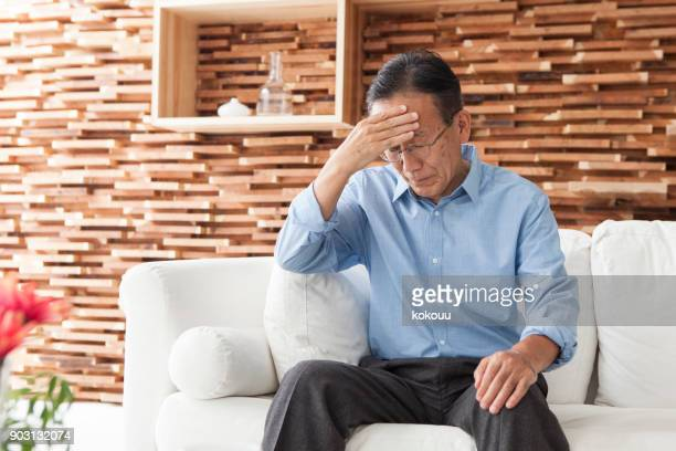 a man with a headache. - tree man syndrome stock photos and pictures