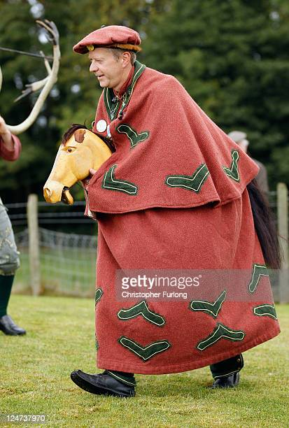 A man with a hobby horse takes part in the Abbots Bromley Horn Dance on September 12 2011 in Abbots Bromley United Kingdom The dance comprising of...