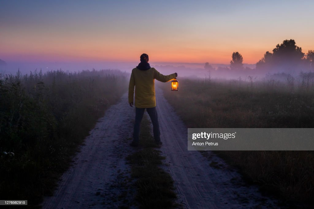 Man with a lantern in the fog. : Stock Photo
