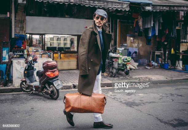 Man with a leather bag