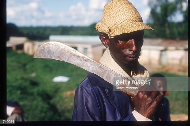 A man with a machete poses near the refugee camp May 5 1994 in Rukumbell Rwanda Hundreds of Tutsis were killed at the Rukara Catholic mission April...