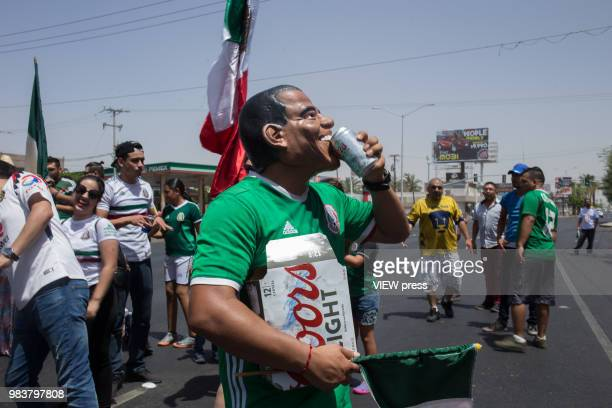 A man with a mask of former president Obama celebrates after winning their FIFA World Cup Group F South Korea vs Mexico match on June 23 2018 in...