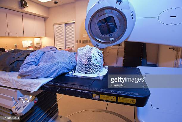 Man with a mask undergoing radiation therapy