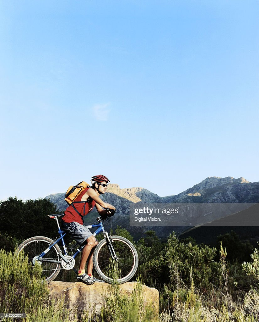 Man With a Mountain Bike Out in the Wilderness : Stock Photo