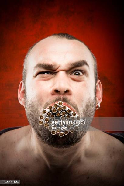 man with a mouth full of many cigarettes - ugly bald man stock pictures, royalty-free photos & images