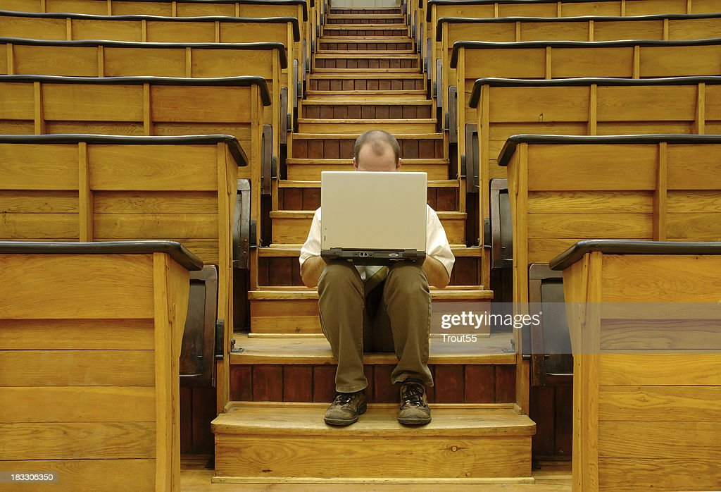 man with a notebook at university : Stock Photo