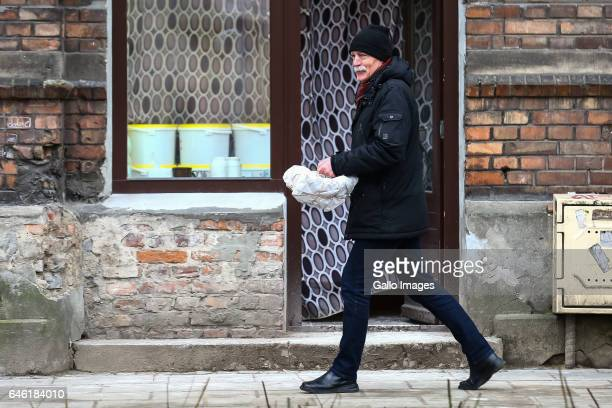 A man with a pack of donuts seen during Fat Thursday on February 23 in Warsaw Poland Fat Thursday is a traditional Catholic Christian feast...