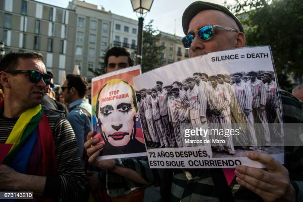 Man with a picture of Vladimir Putting and a picture of a concentration camp, during a protest supporting LGTB in Chechnya.
