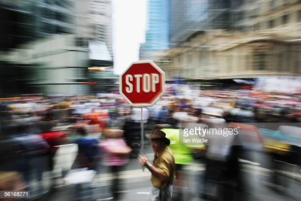 A man with a placard takes part in a demonstration opposing the Australian Federal Government's planned new industrial relations laws November 15...