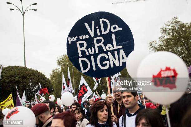 A man with a placard that reads 'for a dignified rural life' protesting during a demonstration demanding measures to stop depopulation and to demand...