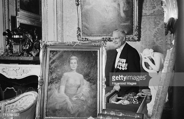 A man with a portrait of American actress Grace Kelly on the day of her civil marriage ceremony to Rainier III Prince of Monaco 18th April 1956...