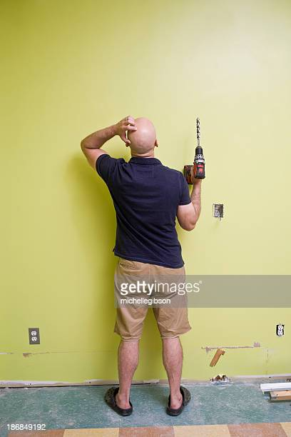 Man with a power drill doing home repairs